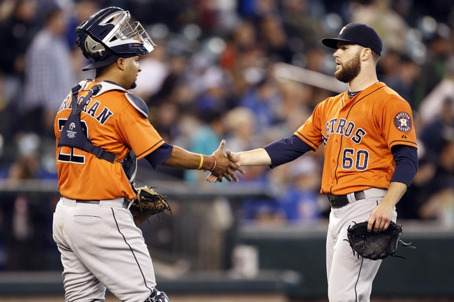 May 25, 2014; Seattle, WA, USA; Houston Astros pitcher Dallas Keuchel (60) is greeted by catcher Carlos Corporan (22) after the final out of a 4-1 victory over the Seattle Mariners at Safeco Field. Mandatory Credit: Joe Nicholson-USA TODAY Sports