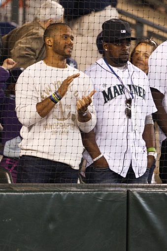 May 25, 2014; Seattle, WA, USA; Seattle Seahawks quarterback Russell Wilson (3, left) and running back Robert Turbin (22) stand during the ninth innings of a game between the Seattle Mariners and Houston Astros at Safeco Field. Mandatory Credit: Joe Nicholson-USA TODAY Sports