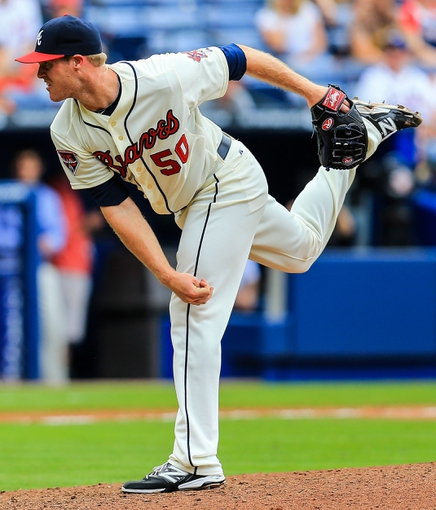 Apr 13, 2014; Atlanta, GA, USA; Atlanta Braves starting pitcher Gus Schlosser (50) pitches in the ninth inning against the Washington Nationals at Turner Field. The Braves won 10-2. Mandatory Credit: Daniel Shirey-USA TODAY Sports