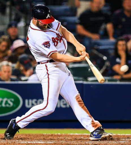 Apr 21, 2014; Atlanta, GA, USA; Atlanta Braves catcher Evan Gattis (24) hits a walk off two run home run in the tenth inning against the Miami Marlins at Turner Field. Mandatory Credit: Daniel Shirey-USA TODAY Sports