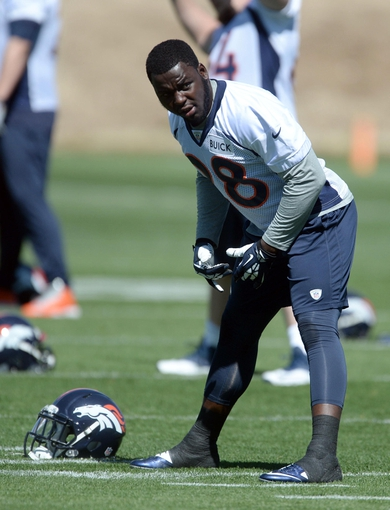 May 28, 2013; Englewood, CO, USA; Denver Broncos running back Montee Ball (28) warms up before the start of organized team activities at the Broncos training facility. Mandatory Credit: Ron Chenoy-USA TODAY Sports