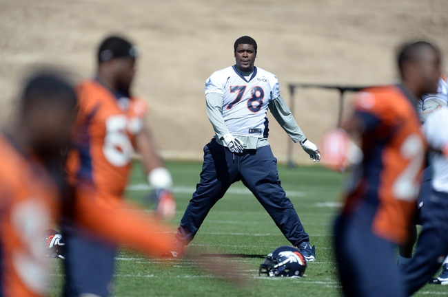 May 28, 2013; Englewood, CO, USA; Denver Broncos tackle Ryan Clady (78) warms up before the start of organized team activities at the Broncos training facility. Mandatory Credit: Ron Chenoy-USA TODAY Sports
