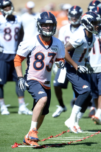 May 28, 2013; Englewood, CO, USA; Denver Broncos wide receiver Wes Welker (83) runs a warm up drill during organized team activities at the Broncos training facility. Mandatory Credit: Ron Chenoy-USA TODAY Sports