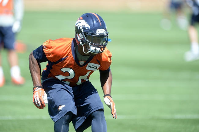 May 28, 2013; Englewood, CO, USA; Denver Broncos free safety Rahim Moore (26) runs a drill during organized team activities at the Broncos training facility. Mandatory Credit: Ron Chenoy-USA TODAY Sports