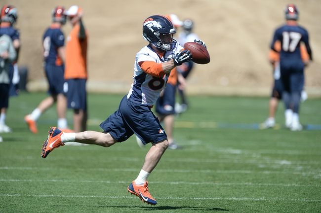 May 28, 2013; Englewood, CO, USA; Denver Broncos wide receiver Wes Welker (83) catches a pass during organized team activities at the Broncos training facility. Mandatory Credit: Ron Chenoy-USA TODAY Sports