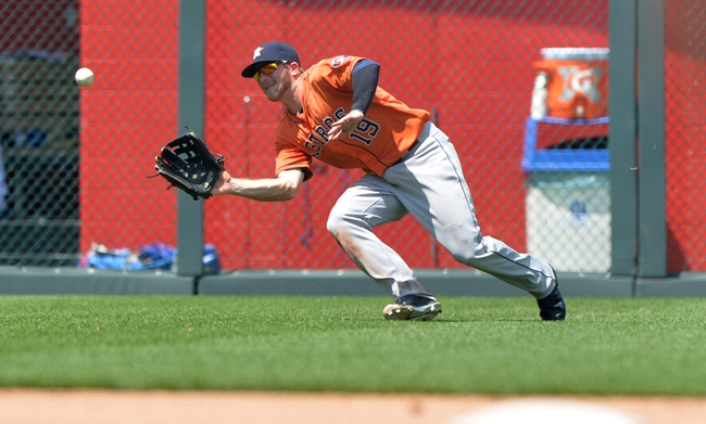 May 28, 2014; Kansas City, MO, USA; Houston Astros left fielder Robbie Grossman (19) makes a running catch for an out against the Kansas City Royals during the fourth inning at Kauffman Stadium. Mandatory Credit: Peter G. Aiken-USA TODAY Sports