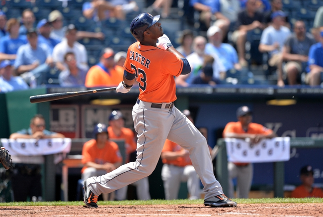 May 28, 2014; Kansas City, MO, USA; Houston Astros batter Chris Carter (23) hits a solo home run against the Kansas City Royals  during the fifth inning at Kauffman Stadium. Mandatory Credit: Peter G. Aiken-USA TODAY Sports
