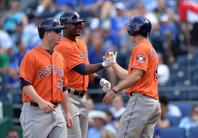 May 28, 2014; Kansas City, MO, USA; Houston Astros batter Chris Carter (23) celebrates with teammates after hitting a three run home run against the Kansas City Royals during the sixth inning at Kauffman Stadium. Mandatory Credit: Peter G. Aiken-USA TODAY Sports