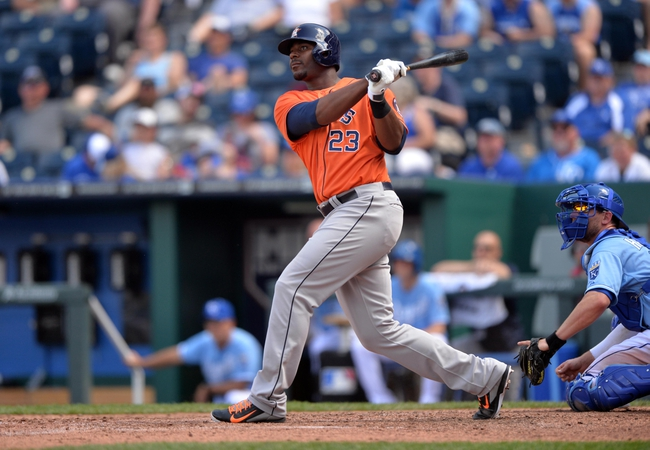 May 28, 2014; Kansas City, MO, USA; Houston Astros batter Chris Carter (23) hits a three run home run against the Kansas City Royals during the sixth inning at Kauffman Stadium. Mandatory Credit: Peter G. Aiken-USA TODAY Sports
