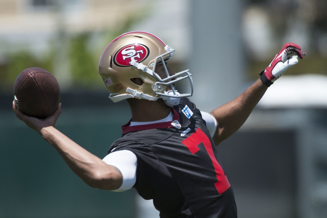 May 28, 2014; Santa Clara, CA, USA; San Francisco 49ers quarterback Colin Kaepernick (7) passes the football during organized team activities at the SAP Performance Facility. Mandatory Credit: Kyle Terada-USA TODAY Sports