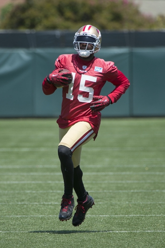 May 28, 2014; Santa Clara, CA, USA; San Francisco 49ers wide receiver Michael Crabtree (15) runs with the football during organized team activities at the SAP Performance Facility. Mandatory Credit: Kyle Terada-USA TODAY Sports
