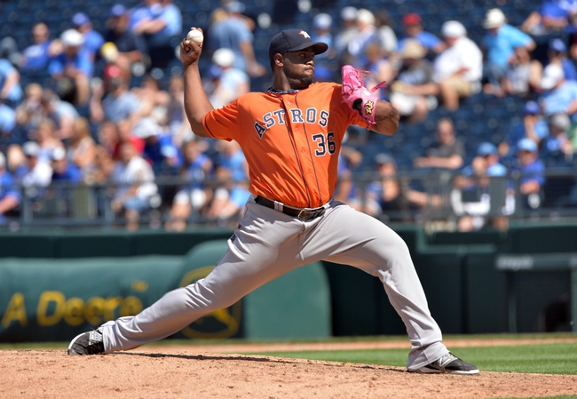 May 28, 2014; Kansas City, MO, USA; Houston Astros pitcher Jerome Williams (36) delivers a pitch against the Kansas City Royals during the seventh inning at Kauffman Stadium. The Astros beat the Royals 9-3. Mandatory Credit: Peter G. Aiken-USA TODAY Sports