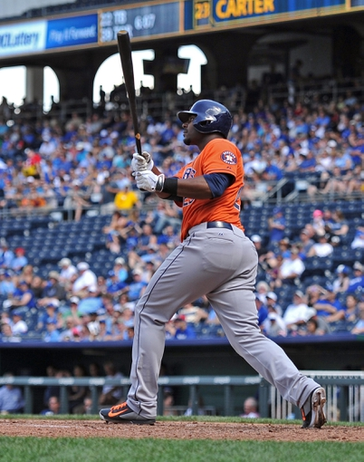 May 28, 2014; Kansas City, MO, USA; Houston Astros batter Chris Carter (23) hits a solo home run against the Kansas City Royals  during the fifth inning at Kauffman Stadium. The Astros beat the Royals 9-3. Mandatory Credit: Peter G. Aiken-USA TODAY Sports