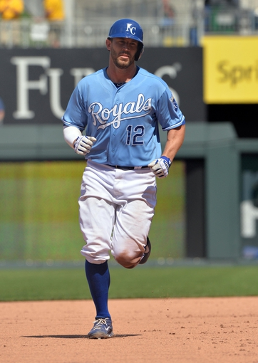 May 28, 2014; Kansas City, MO, USA; Kansas City Royals catcher Brett Hayes (12) rounds the bases after hitting a solo home run against the Houston Astros during the seventh inning at Kauffman Stadium. The Astros beat the Royals 9-3. Mandatory Credit: Peter G. Aiken-USA TODAY Sports