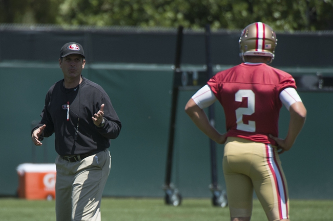 May 28, 2014; Santa Clara, CA, USA; San Francisco 49ers head coach Jim Harbaugh (left) instructs quarterback Blaine Gabbert (2) during organized team activities at the SAP Performance Facility. Mandatory Credit: Kyle Terada-USA TODAY Sports
