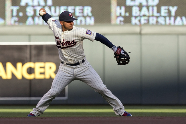 May 28, 2014; Minneapolis, MN, USA; Minnesota Twins shortstop Eduardo Escobar (5) throws the ball to first base for an out in the first inning against the Texas Rangers at Target Field. Mandatory Credit: Jesse Johnson-USA TODAY Sports