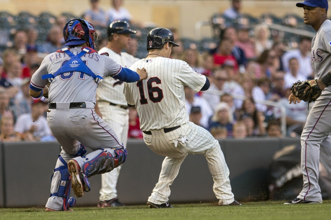 May 28, 2014; Minneapolis, MN, USA; Texas Rangers catcher Robinson Chirinos (61) tags out Minnesota Twins left fielder Josh Willingham (16) in a run down in the second inning at Target Field. Mandatory Credit: Jesse Johnson-USA TODAY Sports