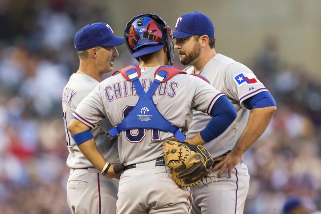 May 28, 2014; Minneapolis, MN, USA; Texas Rangers pitching coach Mike Maddux talks to catcher Robinson Chirinos (61) and starting pitcher Joe Saunders (47) in the second inning against the Minnesota Twins at Target Field. Mandatory Credit: Jesse Johnson-USA TODAY Sports
