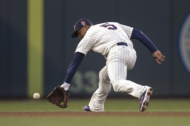 May 28, 2014; Minneapolis, MN, USA; Minnesota Twins shortstop Eduardo Escobar (5) fields a ground ball in the fifth inning against the Texas Rangers at Target Field. Mandatory Credit: Jesse Johnson-USA TODAY Sports