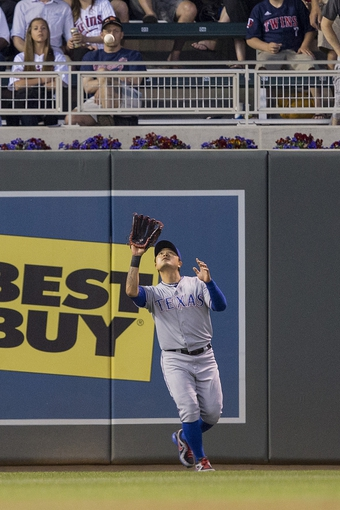 May 28, 2014; Minneapolis, MN, USA; Texas Rangers left fielder Shin-Soo Choo (17) catches a fly ball in the fifth inning against the Minnesota Twins at Target Field. Mandatory Credit: Jesse Johnson-USA TODAY Sports