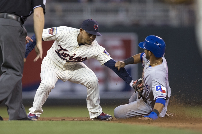 May 28, 2014; Minneapolis, MN, USA; Minnesota Twins shortstop Eduardo Escobar (5) tags out Texas Rangers second baseman Luis Sardinas (3) trying to steal second base in the fifth inning at Target Field. Mandatory Credit: Jesse Johnson-USA TODAY Sports