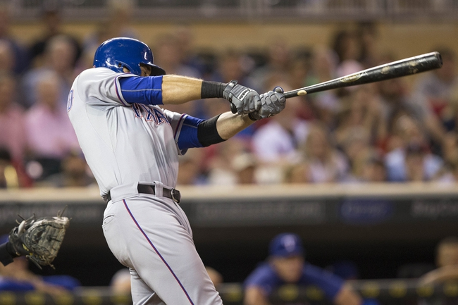 May 28, 2014; Minneapolis, MN, USA; Texas Rangers designated hitter Mitch Moreland (18) hits a single in the sixth inning against the Minnesota Twins at Target Field. Mandatory Credit: Jesse Johnson-USA TODAY Sports