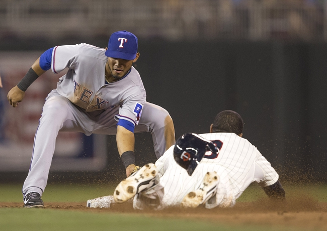May 28, 2014; Minneapolis, MN, USA; Texas Rangers second baseman Luis Sardinas (3) tags out Minnesota Twins third baseman Eduardo Nunez (9) trying steal second base in the sixth inning at Target Field. Mandatory Credit: Jesse Johnson-USA TODAY Sports