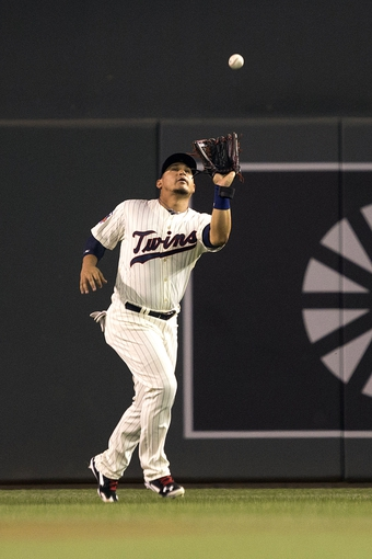 May 28, 2014; Minneapolis, MN, USA; Minnesota Twins right fielder Oswaldo Arcia (31) catches a fly ball in the ninth inning against the Texas Rangers at Target Field. The Rangers won 1-0. Mandatory Credit: Jesse Johnson-USA TODAY Sports