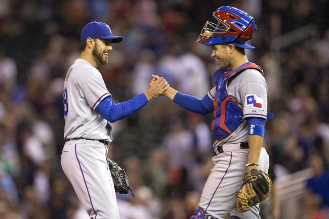 May 28, 2014; Minneapolis, MN, USA; Texas Rangers relief pitcher Joakim Soria (28) celebrates with catcher Robinson Chirinos (61) after beating the Minnesota Twins at Target Field. The Rangers won 1-0. Mandatory Credit: Jesse Johnson-USA TODAY Sports