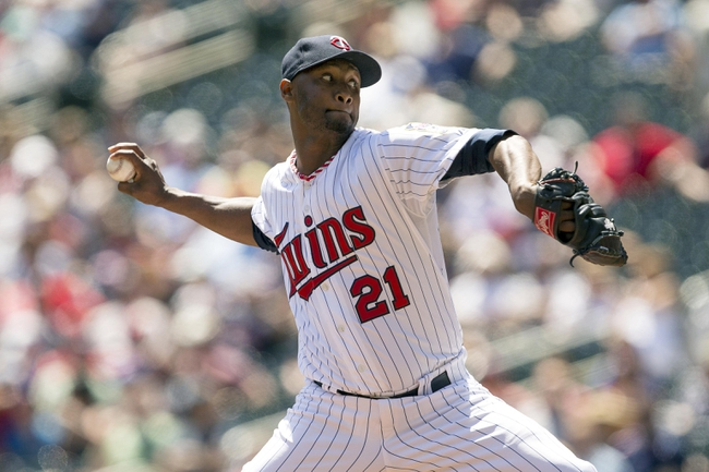May 29, 2014; Minneapolis, MN, USA; Minnesota Twins relief pitcher Samuel Deduno (21) delivers a pitch in the first inning against the Texas Rangers at Target Field. Mandatory Credit: Jesse Johnson-USA TODAY Sports