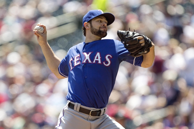 May 29, 2014; Minneapolis, MN, USA; Texas Rangers starting pitcher Nick Martinez (22) delivers a pitch in the first inning against the Minnesota Twins at Target Field. Mandatory Credit: Jesse Johnson-USA TODAY Sports