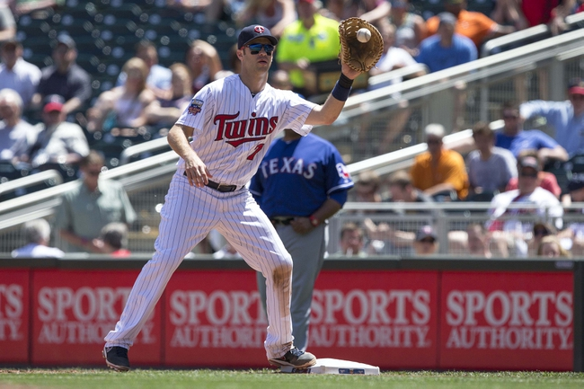 May 29, 2014; Minneapolis, MN, USA; Minnesota Twins first baseman Joe Mauer (7) catches the ball for an out in the sixth inning against the Texas Rangers at Target Field. Mandatory Credit: Jesse Johnson-USA TODAY Sports