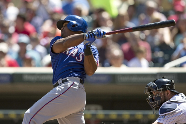 May 29, 2014; Minneapolis, MN, USA; Texas Rangers third baseman Adrian Beltre (29) hits a single in the seventh inning against the Minnesota Twins at Target Field. Mandatory Credit: Jesse Johnson-USA TODAY Sports