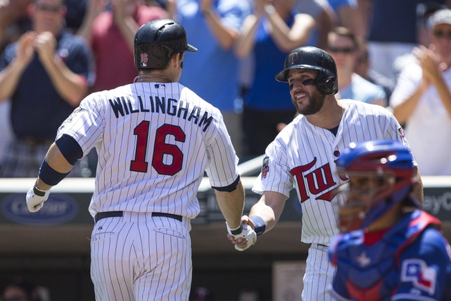 May 29, 2014; Minneapolis, MN, USA; Minnesota Twins designated hitter Josh Willingham (16) celebrates with third baseman Trevor Plouffe (24) after hitting a home run in the fifth inning against the Texas Rangers at Target Field. Mandatory Credit: Jesse Johnson-USA TODAY Sports