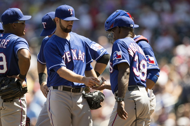 May 29, 2014; Minneapolis, MN, USA; Texas Rangers relief pitcher Nick Martinez (22) gets pulled from the game by manager Ron Washington (38) in the sixth inning against the Minnesota Twins at Target Field. Mandatory Credit: Jesse Johnson-USA TODAY Sports