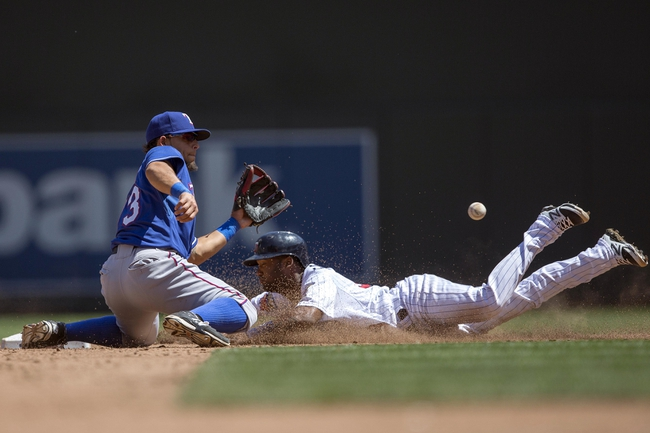 May 29, 2014; Minneapolis, MN, USA; Minnesota Twins center fielder Danny Santana (39) slides into second base before Texas Rangers second baseman Rougned Odor (73) can catch the ball in the sixth inning at Target Field. Mandatory Credit: Jesse Johnson-USA TODAY Sports