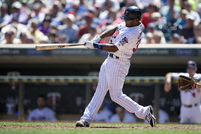 May 29, 2014; Minneapolis, MN, USA; Minnesota Twins center fielder Danny Santana (39) hits a single in the sixth inning against the Texas Rangers at Target Field. Mandatory Credit: Jesse Johnson-USA TODAY Sports