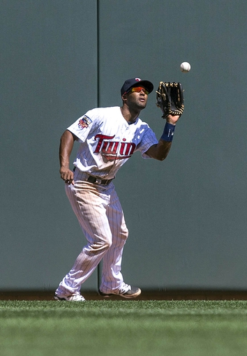 May 29, 2014; Minneapolis, MN, USA; Minnesota Twins center fielder Danny Santana (39) catches a fly ball in the ninth inning against the Texas Rangers at Target Field. The Rangers won 5-4. Mandatory Credit: Jesse Johnson-USA TODAY Sports