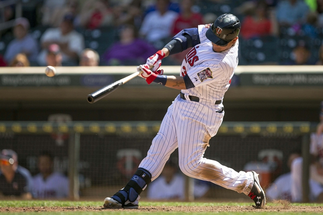 May 29, 2014; Minneapolis, MN, USA; Minnesota Twins right fielder Oswaldo Arcia (31) hits a single in the ninth inning against the Texas Rangers at Target Field. The Rangers won 5-4. Mandatory Credit: Jesse Johnson-USA TODAY Sports