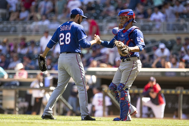 May 29, 2014; Minneapolis, MN, USA; Texas Rangers relief pitcher Joakim Soria (28) celebrates with catcher Robinson Chirinos (61) after beating the Minnesota Twins at Target Field. The Rangers won 5-4. Mandatory Credit: Jesse Johnson-USA TODAY Sports