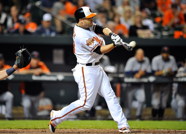 May 13, 2014; Baltimore, MD, USA; Baltimore Orioles first baseman Steve Pearce (28) bats in the ninth inning against the Detroit Tigers at Oriole Park at Camden Yards. The Tigers defeated the Orioles 4-1. Mandatory Credit: Joy R. Absalon-USA TODAY Sports