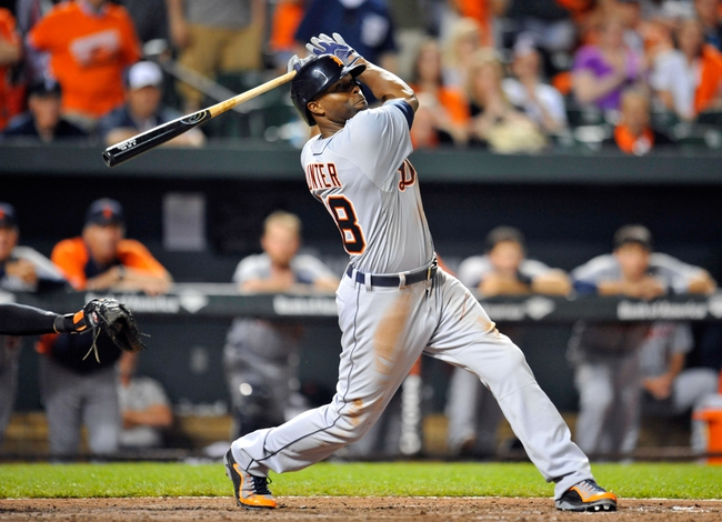 May 13, 2014; Baltimore, MD, USA; Detroit Tigers right fielder Torii Hunter (48) bats in the ninth inning against the Baltimore Orioles at Oriole Park at Camden Yards. The Tigers defeated the Orioles 4-1. Mandatory Credit: Joy R. Absalon-USA TODAY Sports