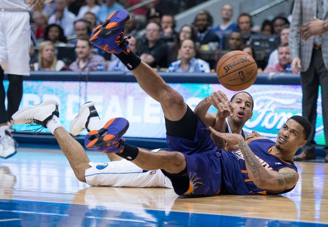 Apr 12, 2014; Dallas, TX, USA; Dallas Mavericks guard Devin Harris (20) and Phoenix Suns guard Gerald Green (14) during the game at the American Airlines Center. The Mavericks defeated the Suns 101-98. Mandatory Credit: Jerome Miron-USA TODAY Sports