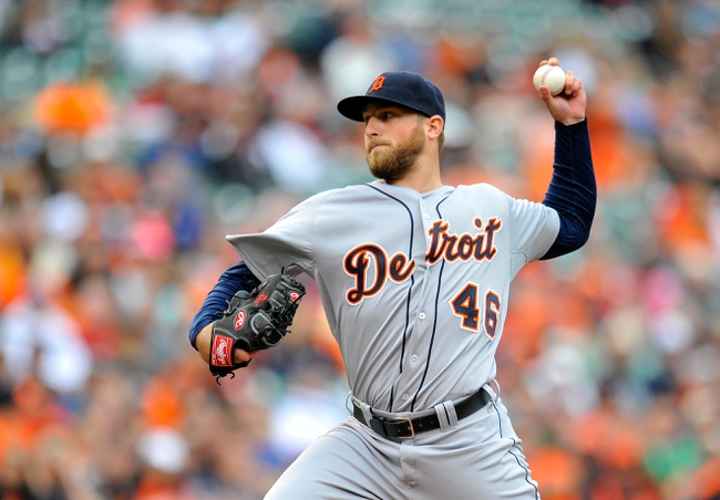 May 14, 2014; Baltimore, MD, USA; Detroit Tigers pitcher Ian Krol (46) pitches in the seventh inning against the Baltimore Orioles at Oriole Park at Camden Yards. The Tigers defeated the Orioles 7-5. Mandatory Credit: Joy R. Absalon-USA TODAY Sports