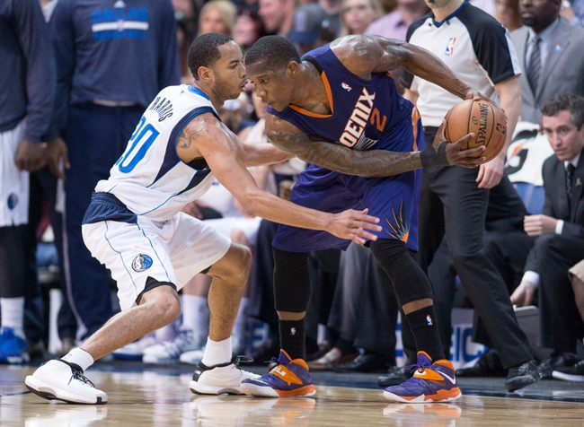 Apr 12, 2014; Dallas, TX, USA; Dallas Mavericks guard Devin Harris (20) and Phoenix Suns guard Eric Bledsoe (2) during the game at the American Airlines Center. The Mavericks defeated the Suns 101-98. Mandatory Credit: Jerome Miron-USA TODAY Sports