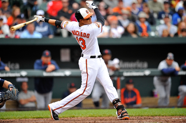 May 14, 2014; Baltimore, MD, USA; Baltimore Orioles third baseman Manny Machado (13) bats in the seventh inning against the Detroit Tigers at Oriole Park at Camden Yards. The Tigers defeated the Orioles 7-5. Mandatory Credit: Joy R. Absalon-USA TODAY Sports