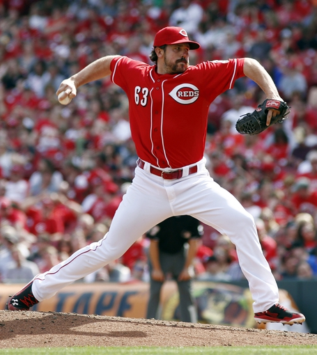 Apr 13, 2014; Cincinnati, OH, USA; Cincinnati Reds relief pitcher Sam LeCure (63) throws against the Tampa Bay Rays during the eighth inning at Great American Ball Park.The Reds won 12-4.  Mandatory Credit: David Kohl-USA TODAY Sports