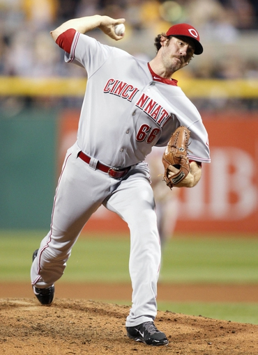 Sep 20, 2013; Pittsburgh, PA, USA; Cincinnati Reds relief pitcher Logan Ondrusek (66) pitches against the Pittsburgh Pirates during the seventh inning at PNC Park. The Cincinnati Reds won 6-5 in ten innings. Mandatory Credit: Charles LeClaire-USA TODAY Sports