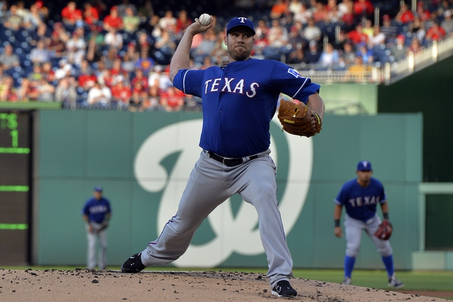 May 30, 2014; Washington, DC, USA; Texas Rangers starting pitcher Colby Lewis (48) p[itches during the first inning against the Washington Nationals at Nationals Park. Mandatory Credit: Tommy Gilligan-USA TODAY Sports