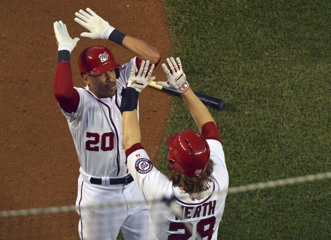 May 30, 2014; Washington, DC, USA; Washington Nationals shortstop Ian Desmond (20) celebrates with  right fielder Jayson Werth (28) after hitting a three run home run in the fourth inning against the Texas Rangers at Nationals Park. Mandatory Credit: Tommy Gilligan-USA TODAY Sports